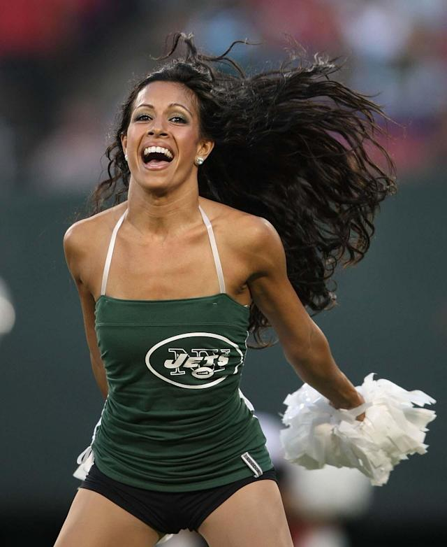 EAST RUTHERFORD, NJ - AUGUST 14: New York Jets cheerleaders perform against the St. Louis Rams during their preseason game at Giants Stadium on August 14, 2009 in East Rutherford, New Jersey. (Photo by Nick Laham/Getty Images)