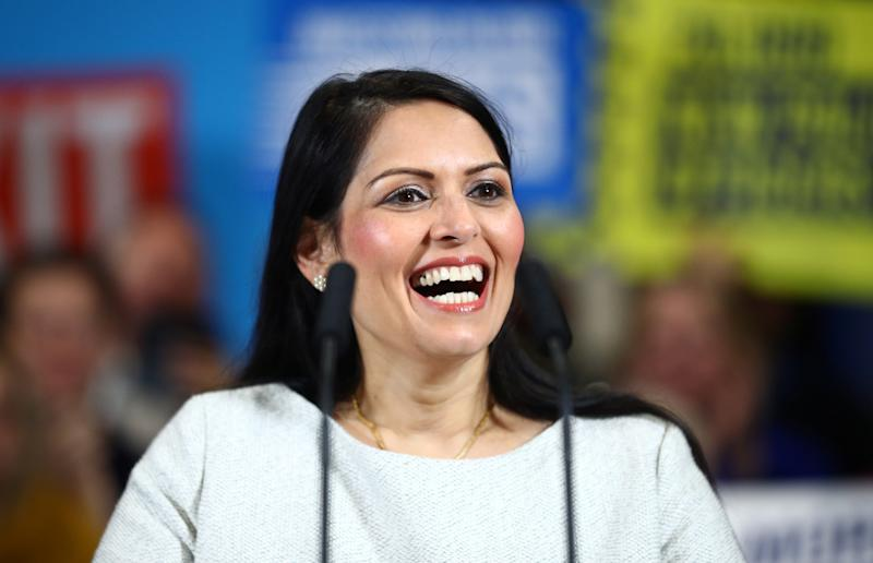 COLCHESTER, ENGLAND - DECEMBER 02: Britain's Home Secretary Priti Patel reacts during a campaign rally event on December 2, 2019 in Colchester, England. (Photo by Hannah McKay - WPA Pool/Getty Images)