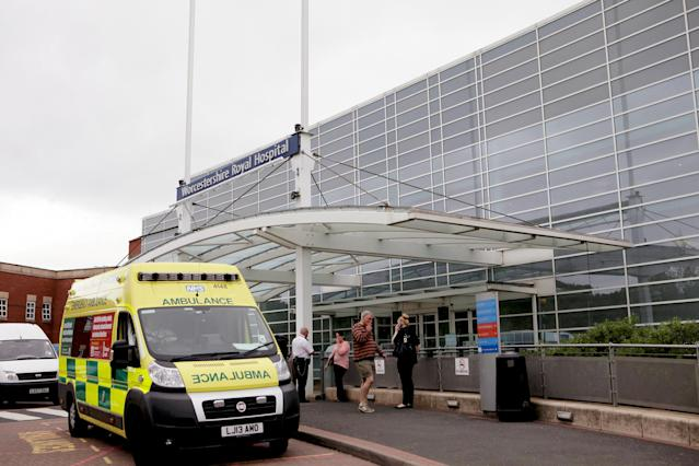 A string of 23 ambulances were forced to queue outside the overstretched A&E department just weeks after a patient died in one while waiting for treatment (SWNS)