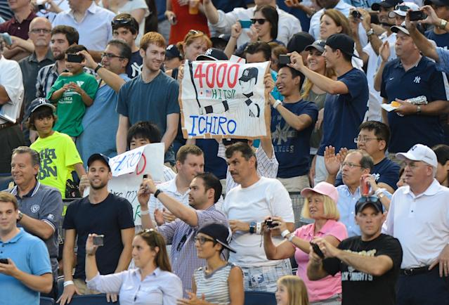 NEW YORK, NY - AUGUST 21: Fans hold up a sign for Ichiro Suzuki #31 of the New York Yankees after his 4,000th career hit on a single in the 1st inning of the New York Yankees game against the Toronto Blue Jays at Yankee Stadium on August 21, 2013 in the Bronx borough of New York City. (Photo by Ron Antonelli/Getty Images)