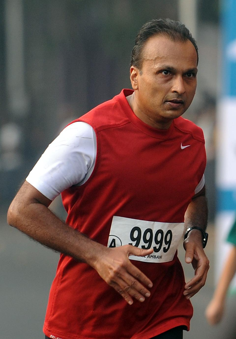 Indian industrialist Anil Ambani runs during the Standard Chartered Mumbai Marathon 2012, in Mumbai on January 15, 2012. Laban Moiben of Kenya won the race in a time of 2:10:48 hours. AFP PHOTO/Punit PARANJPE