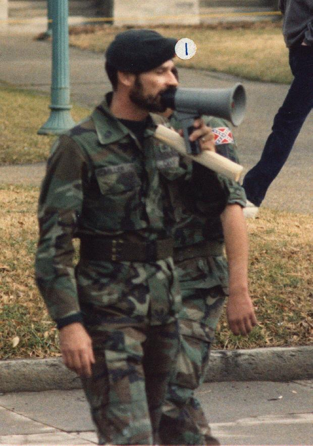 In this Jan. 18, 1986 photo released by Southern Poverty Law Center shows Frazier Glenn Cross, also known as Frazier Glenn Miller, at a Martin Luther King holiday protest in Raleigh, N.C. Cross, 73, accused of killing three people in attacks at a Jewish community center and Jewish retirement complex near Kansas City on Sunday, April 13, 2014, is a known white supremacist and former Ku Klux Klan leader who was once the subject of a nationwide manhunt. He was booked into Johnson County jail on a preliminary charge of first-degree murder. The identifier label above Cross' head was placed by the source. (AP Photo/Southern Poverty Law Center)