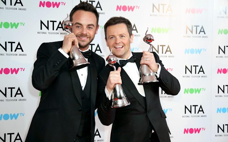 Anthony McPartlin and Declan Donnelly pose in the press room with the The Bruce Forsyth Entertainment Award and TV Presenter Award at the National Television Awards - WireImage