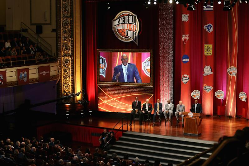 """SPRINGFIELD, MA - SEPTEMBER 08: A general view as Naismith Memorial Basketball Hall of Famers Artis Gilmore, Bobby """"Slick"""" Leonard, Reggie Miller, Spencer Haywood and Rick Barry sit onstage as Naismith Memorial Basketball Hall of Fame Class of 2017 enshrinee George McGinnis speaks during the 2017 Basketball Hall of Fame Enshrinement Ceremony at Symphony Hall on September 8, 2017 in Springfield, Massachusetts. (Photo by Maddie Meyer/Getty Images)"""