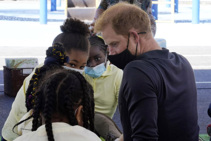 Prince Harry, the Duke of Sussex, sits with students during a visit with his wife Meghan, the Duchess of Sussex, to P.S. 123, the Mahalia Jackson School, in New York's Harlem neighborhood, Friday, Sept. 24, 2021. (AP Photo/Richard Drew)