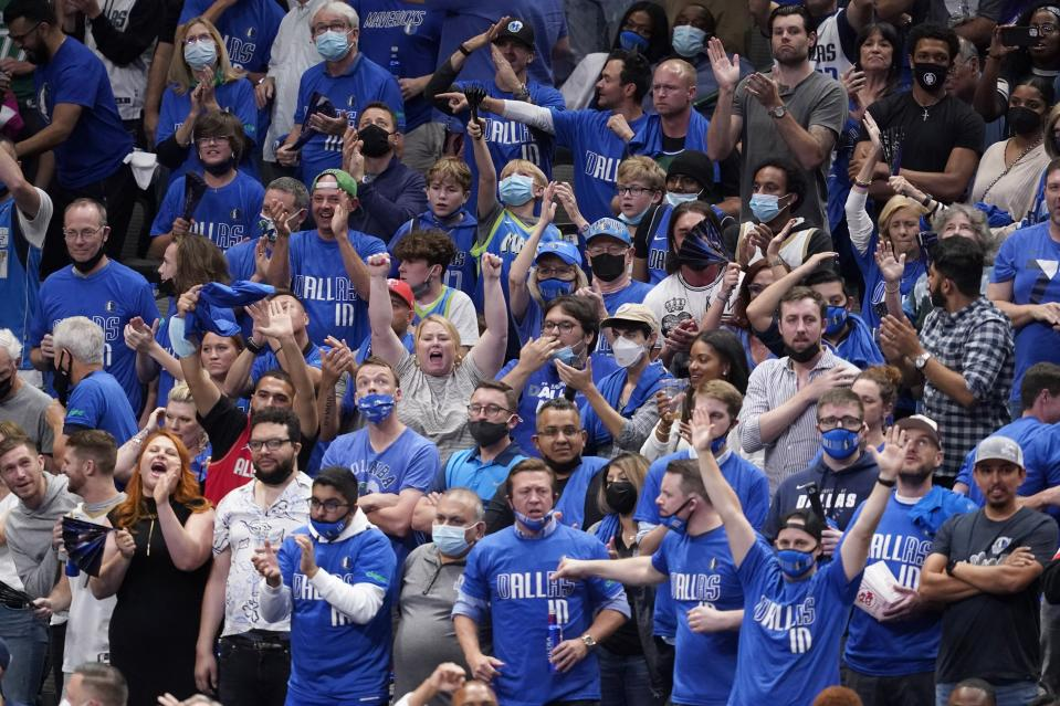 Fans cheer as the Dallas Mavericks play the Los Angeles Clippers in the second half in Game 3 of an NBA basketball first-round playoff series in Dallas, Friday, May 28, 2021. (AP Photo/Tony Gutierrez)