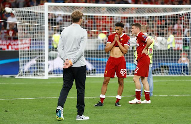 Soccer Football - Champions League Final - Real Madrid v Liverpool - NSC Olympic Stadium, Kiev, Ukraine - May 26, 2018 Liverpool's Trent Alexander-Arnold and James Milner react after the match REUTERS/Kai Pfaffenbach