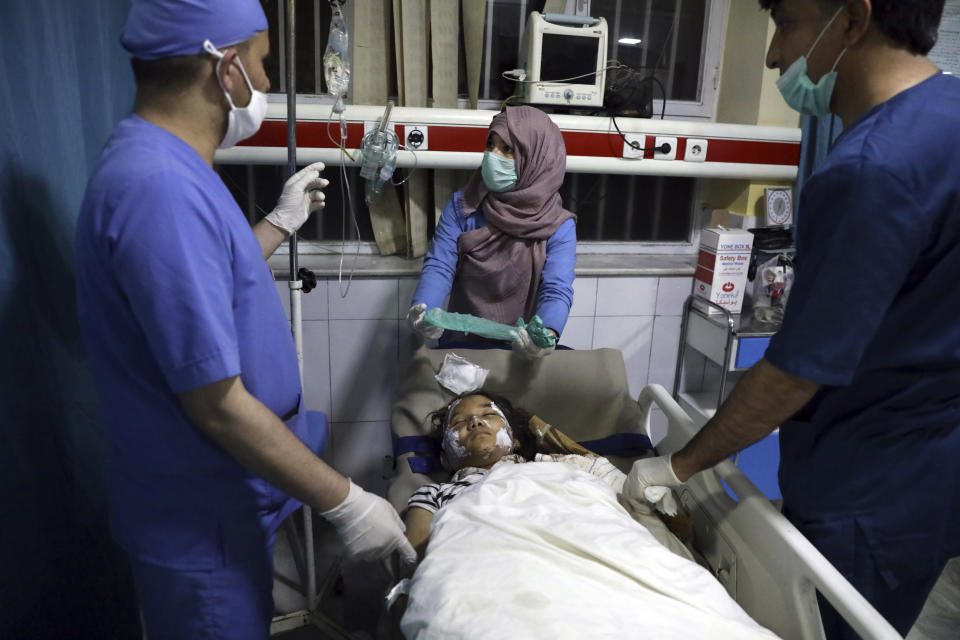 File - In this Saturday, May 8, 2021 file photo, an Afghan school student is treated at a hospital after a bomb explosion near a school west of Kabul, Afghanistan, Saturday, May 8, 2021. The May 8 triple bombing of the Syed-Al-Shahada girls school that killed more than 100, nearly 80 of them Hazara students (AP Photo/Rahmat Gul, File)