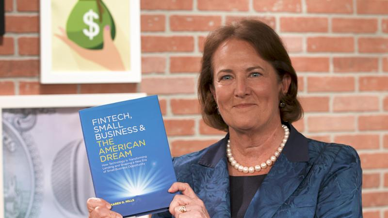 "Karen Mills holds up her book, ""Fintech, Small Business & the American Dream: How Technology Is Transforming Lending and Shaping a New Era of Small Business Opportunity"" in Yahoo Finance's studio."