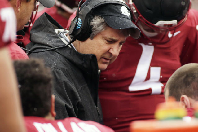 Washington State head coach Mike Leach, center, speaks with his players during the first half of an NCAA college football game against Stanford in Pullman, Wash., Saturday, Nov. 4, 2017. (AP Photo/Young Kwak)
