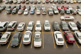 View of parking lot with classic cars.