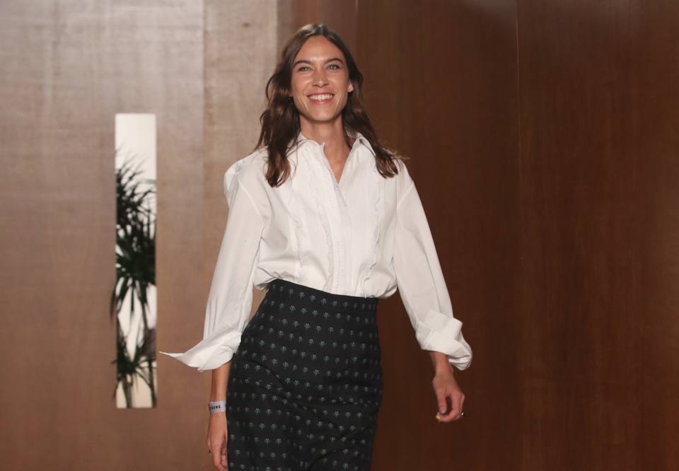 Alexa Chung takes her bow after her debut London Fashion Week show. [Photo: Getty]