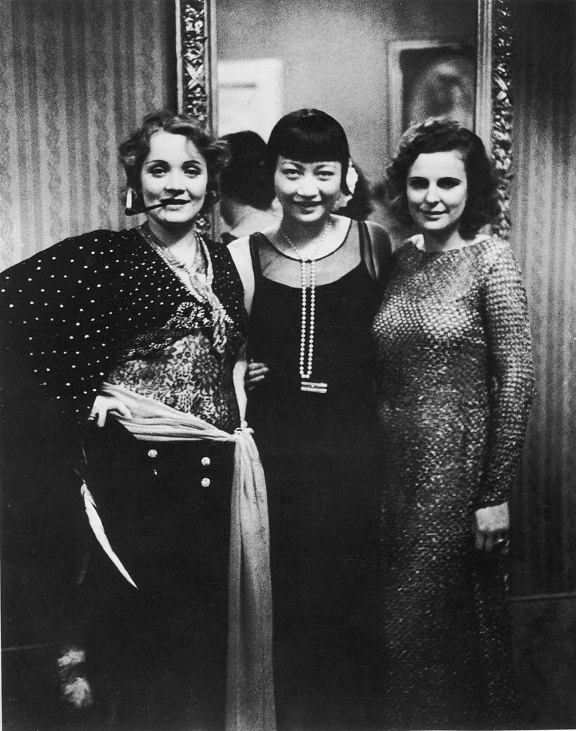 <p>At a Berlin ball, Wong posed with actress Marlene Dietrich and filmmaker Leni Riefenstahl. </p>