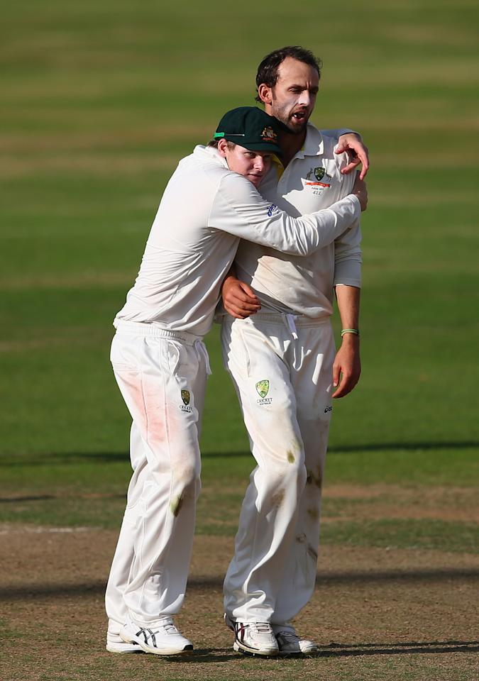 NORTHAMPTON, ENGLAND - AUGUST 16: Nathan Lyon and Steve Smith of Australia celebrates after Lyon claimed a wicket during Day One of the Tour Match between England Lions and Australia at The County Ground on August 16, 2013 in Northampton, England.  (Photo by Ryan Pierse/Getty Images)