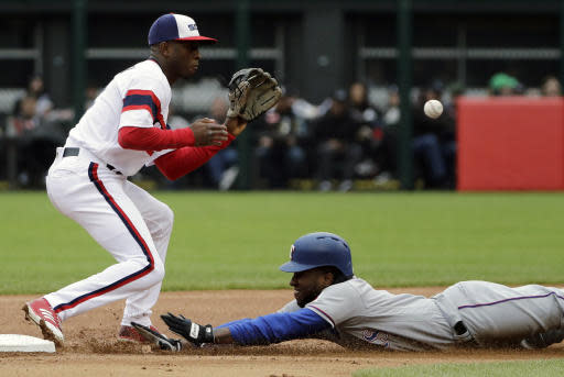 Texas Rangers' Jurickson Profar, right, steals second base as Chicago White Sox shortstop Tim Anderson waits for the ball during the first inning of a baseball game Sunday, May 20, 2018, in Chicago. (AP Photo/Nam Y. Huh)