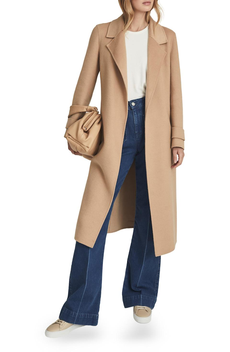 """<p><strong>REISS</strong></p><p>nordstrom.com</p><p><a href=""""https://go.redirectingat.com?id=74968X1596630&url=https%3A%2F%2Fwww.nordstrom.com%2Fs%2Freiss-leah-wool-blend-wrap-coat%2F5911720&sref=https%3A%2F%2Fwww.harpersbazaar.com%2Ffashion%2Ftrends%2Fg36946278%2Fnordstrom-anniversary-sale-fashion%2F"""" rel=""""nofollow noopener"""" target=""""_blank"""" data-ylk=""""slk:Shop Now"""" class=""""link rapid-noclick-resp"""">Shop Now</a></p><p><strong>Sale: $370<br></strong></p><p><strong>After Sale: $620</strong></p><p>Camel coats never go out of style. We're eyeing this Reiss number for its tailored silhouette and removable belt. </p>"""