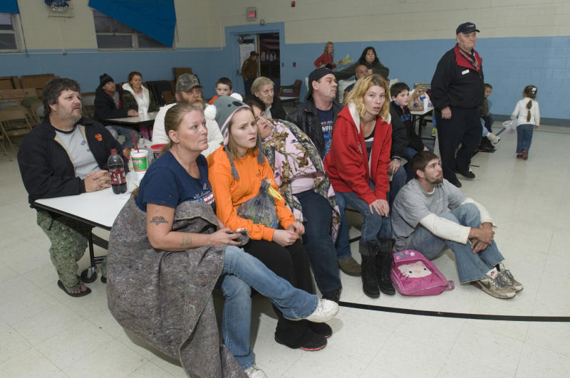 Residents of West Point, Ky., listen as Billy Ash, Mayor of West Point updates the situation as they wait at a Red Cross shelter Wednesday, Oct. 31, 2012 at the Muldraugh Elementary School in Muldraugh, Ky. A Paducah & Louisville Railway train carrying hazardous chemicals derailed just after 6 a.m. EDT Monday. A leak of a potentially explosive material was contained, but authorities say three workers were severely burned in a fire that erupted while contractors were removing debris from the train today in southwest Louisville, Kentucky. (AP Photo/Brian Bohannon)