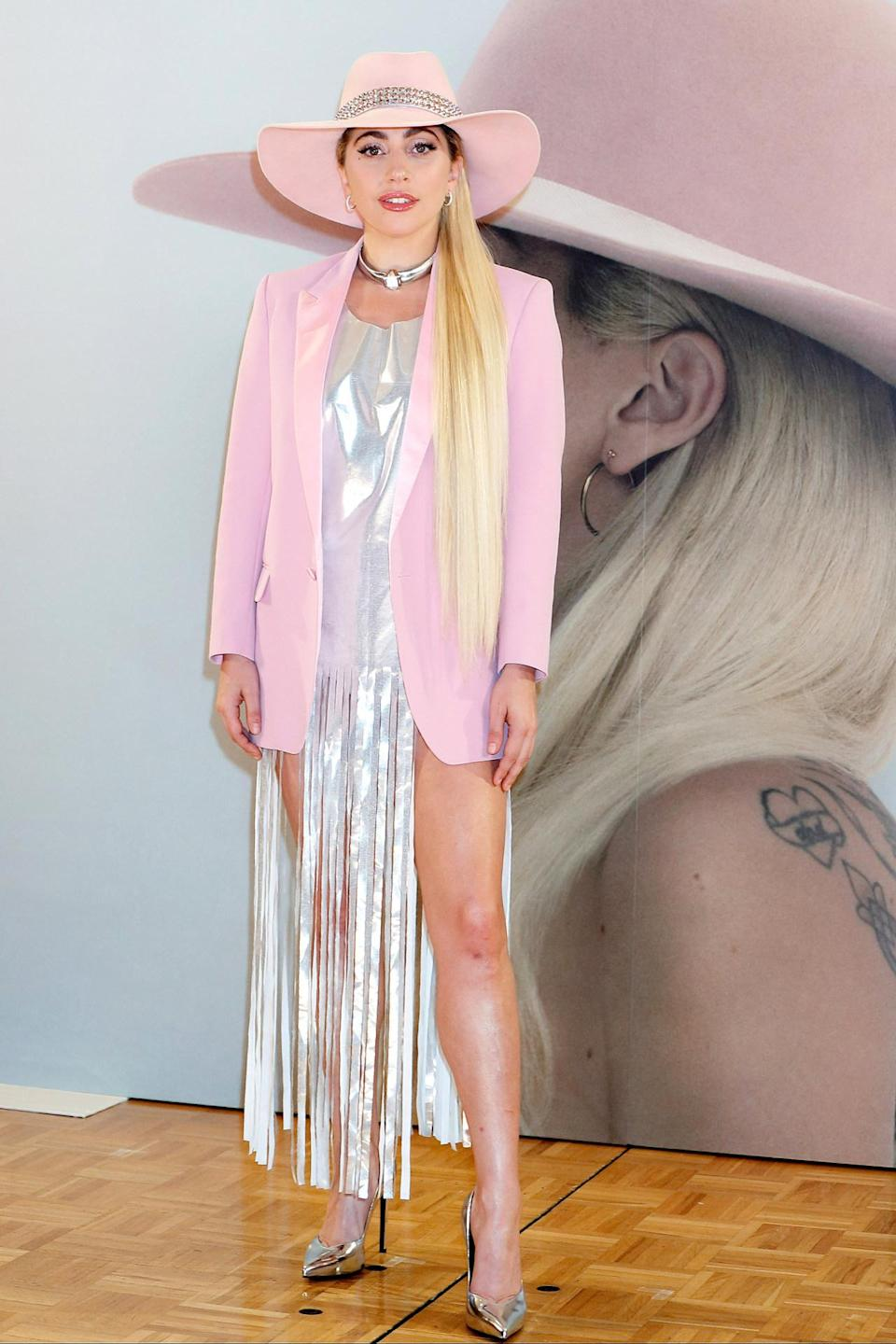 <p>For a photocall in Japan to promote her new album, Gaga showed up wearing a silver T-shirt with strategically-placed fringe detailing, combined with a pink blazer and her go-to pink fedora. <i>(Photo by Splash News)</i></p>