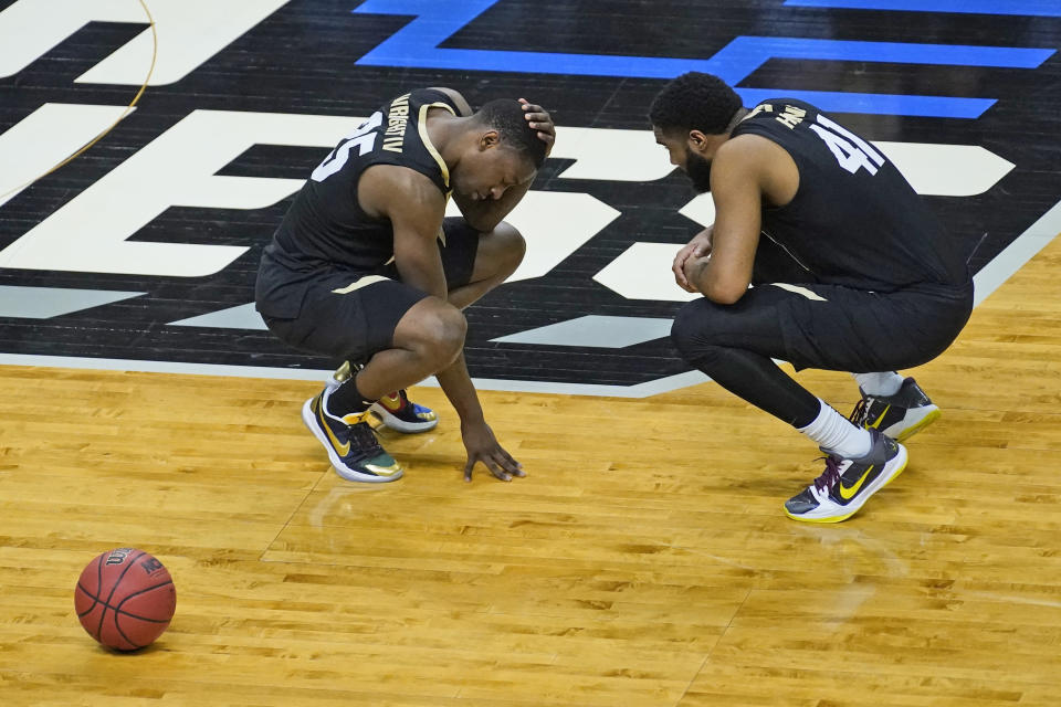 Colorado guard McKinley Wright IV, left, and teammate Colorado forward Jeriah Horne (41) commiserate after their 71-53 loss to Florida State after a second-round game in the NCAA college basketball tournament at Farmers Coliseum in Indianapolis, Monday, March 22, 2021. (AP Photo/Charles Rex Arbogast)