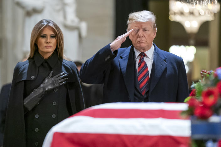 President Donald Trump and first lady Melania Trump pay their respects in the U.S. Capitol Rotunda where former U.S. President George H.W. Bush lies in state Dec. 3, 2018 in Washington, D.C. (Photo: Jim Lo Scalzo-Pool/Getty Images)