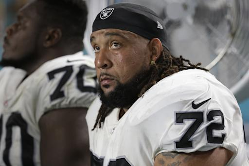 Oakland Raiders offensive tackle Donald Penn (72) sits on the sidelines, during the first half of an NFL football game against the Miami Dolphins, Sunday, Nov. 5, 2017, in Miami Gardens, Fla. (AP Photo/Lynne Sladky)