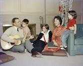 <p>Shirley relaxes with her family, including her husband Charles and her three children, in the living room of their California home.</p>