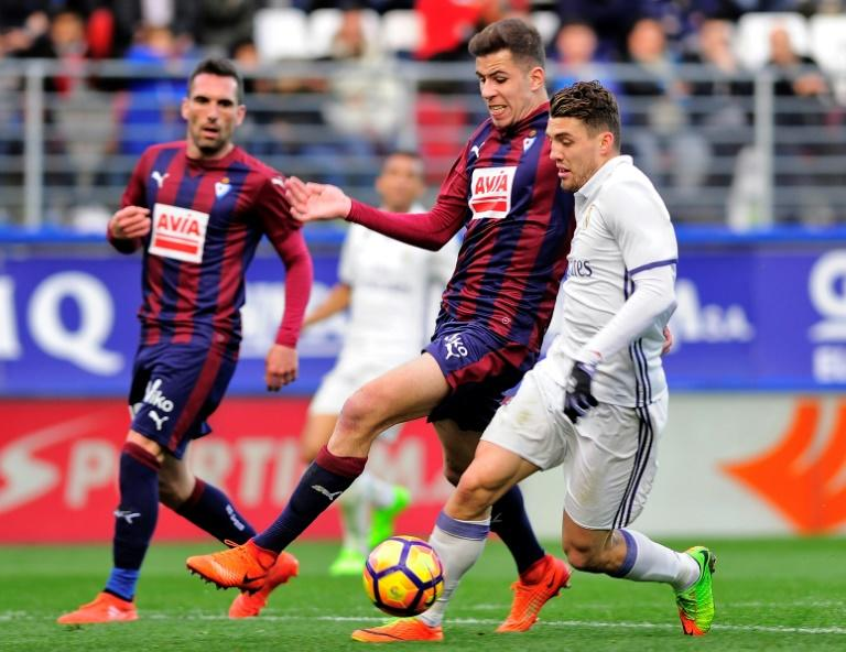 Eibar's midfielder Christian Rivera (C) vies with Real Madrid's midfielder Mateo Kovacic during the Spanish league football match March 4, 2017