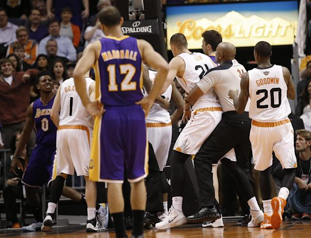 Los Angeles Lakers' Nick Young, left, has words with Phoenix Suns guard Goran Dragic (1) after Young was fouled by Suns' Alex Len during the second quarter of an NBA basketball game Wednesday, Jan. 15, 2014, in Phoenix. (AP Photo/The Arizona Republic, Michael Chow)