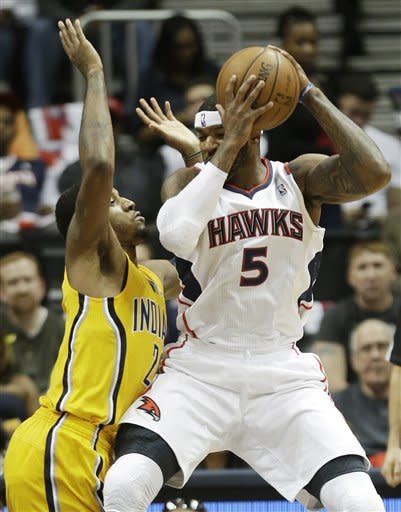 Atlanta Hawks small forward Josh Smith (5) tries to get to the basket against Indiana Pacers small forward Paul George (24) in the first half of an NBA first-round playoff basketball game in Atlanta, Friday, May 3, 2013. (AP Photo/John Bazemore)