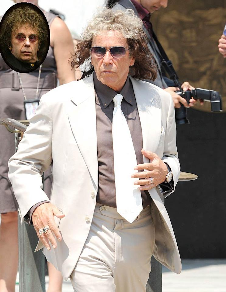 "Yep, that's Al Pacino under there! Passersby in Mineloa, New York, surely did a double take when they saw the actor on the set of the upcoming Phil Spector HBO biopic on Tuesday. Helen Mirren and Jeffrey Tambor also star in the movie. Toby Canham/Asadorian-Mejia/<a href=""http://www.splashnewsonline.com"" target=""new"">Splash News</a> Asadorian-Mejia/Splash News"