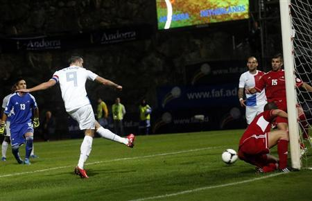 Netherlands' Robin Van Persie (L) scores the second goal against Andorra during their 2014 World Cup qualifying soccer match at Estadi Comunal in Andorra September 10, 2013. REUTERS/Albert Gea