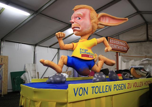 <p>A carnival float, depicting Leader of the Free Democrats Party (FDP) Christian Lindner as a rabbit running, is being prepared at a warehouse ahead of a carnival parade on Rose Monday on Feb. 12, 2018 in Duesseldorf, southern Germany. (Photo: Marcel Kusch/Getty Images) </p>