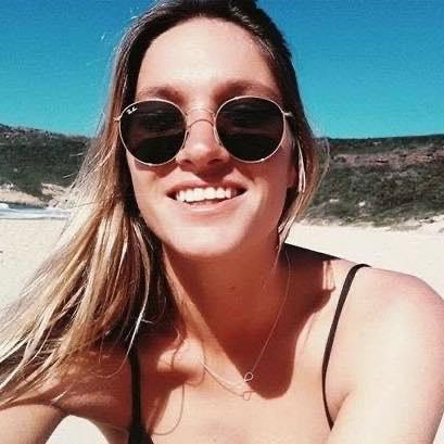 Selfie photo of Fiona Viotti wearing sunglasses at the beach. Source: Facebook