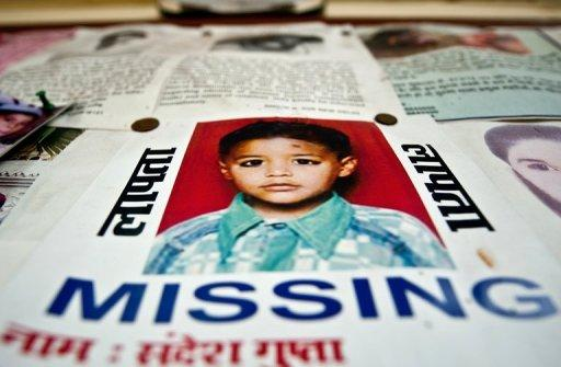 The photographs of missing Indian children are displayed at a police station in New Delhi