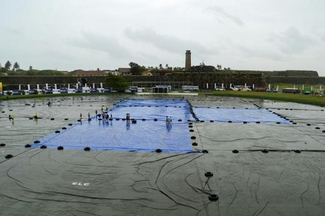 Groundsmen covered the pitch and outfield with plastic sheets as heavy rain doused Galle Stadium the day before the first Test between Sri Lanka and New Zealand (AFP Photo/Ishara S. KODIKARA)