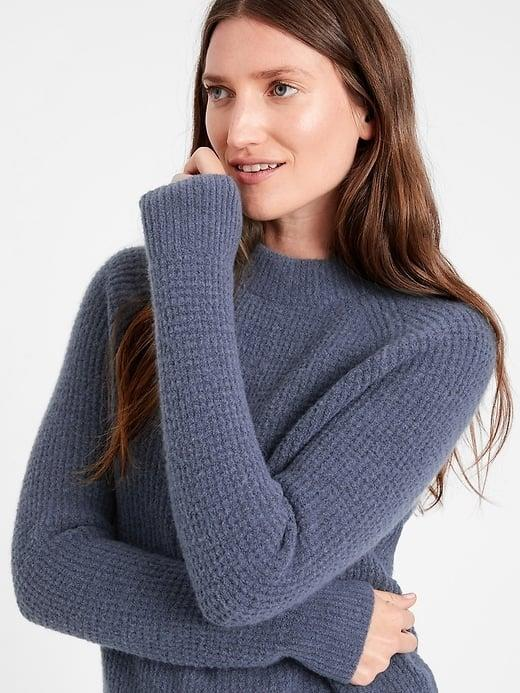 <p>The rich blue shade of this <span>Banana Republic Aire Waffle-Knit Sweater</span> ($78, originally $99) looks nice with jeans.</p>