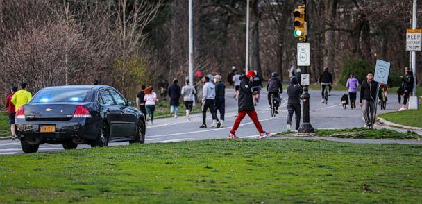 PHOTO: People walk and jog in Brooklyn's Prospect Park Tuesday, March 24, 2020, in New York. (Bebeto Matthews/AP)