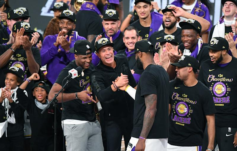 LeBron James and Rob Pelinka clasp hands after the Lakers' championship win.