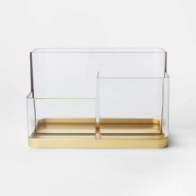 <p>This pretty <span>Project 62 Accent Vanity Organizer Gold</span> ($10) can hold so many different things.</p>
