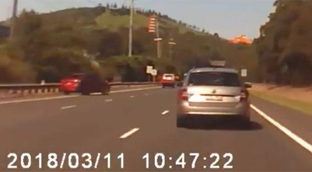 The red car was in the shoulder of the roadway before it veers into the other lanes. Source: Facebook