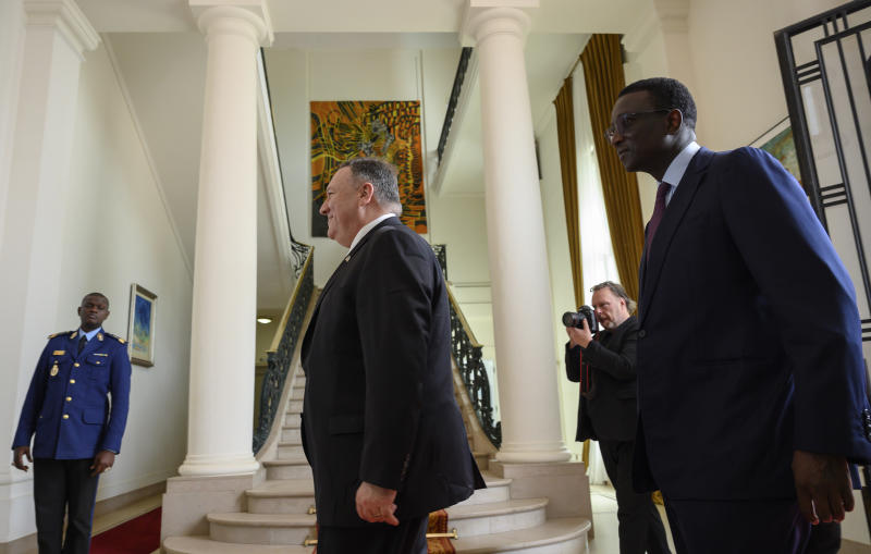 US Secretary of State Mike Pompeo walks with Senegal's Foreign Affairs minister Amadou Ba at the Presidential Palace in Dakar, Senegal, Sunday, Feb. 16, 2020, as part of Pompeo's first visit to sub-Saharan Africa during which he will seek to lay out a positive vision for US cooperation with the continent where China has been increasingly active. (Andrew Carballero-Reynolds/Pool Photo via AP)