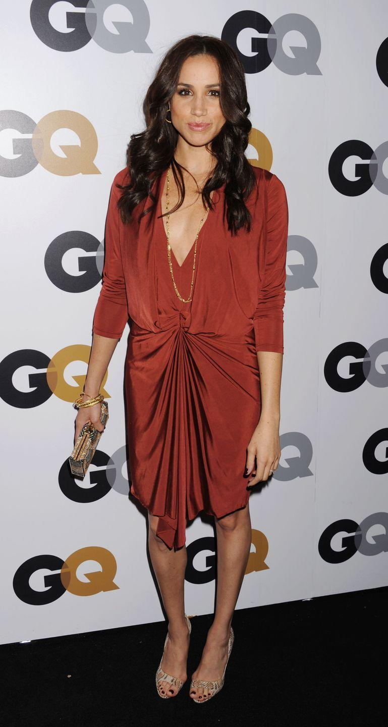 <p>Wearing a stunning ruched rust dress at the GQ Men of the Year Party in L.A. </p>