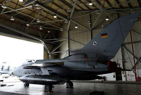 FILE PHOTO: A German Tornado jet is pictured in a hangar before a statement of the German and Turkish defence ministers at the air base in Incirlik