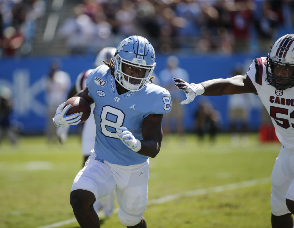 North Carolina running back Michael Carter (8) looks for running room against South Carolina linebacker Ernest Jones in the first half of an NCAA college football game in Charlotte, N.C., Saturday, Aug. 31, 2019. (AP Photo/Nell Redmond)