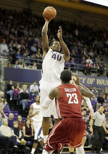 Washington's Shawn Kemp, Jr. (40) shoots over Washington State's D.J. Shelton (23) in the first half of an NCAA college basketball game on Sunday, March 3, 2013, in Seattle. (AP Photo/Ted S. Warren)