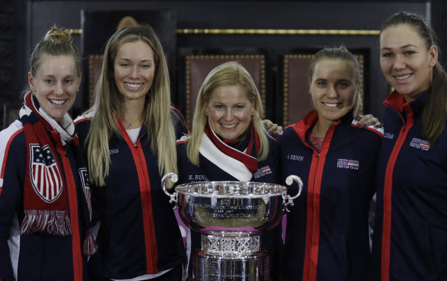 The team of the United States, left to right, Alison Riske, Danielle Rose Collins, captain Kathy Rinaldi, Sofia Kenin and Nicole Melichar pose for a photo in Prague, Czech Republic, Friday, Nov. 9, 2018 after a draw for the tennis Fed Cup Final between Czech Republic and the United States. The final takes place on Saturday, Nov. 10 and Sunday, Nov. 11, 2018. (AP Photo/Petr David Josek)