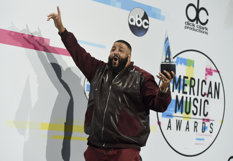 "DJ Khaled poses in the press room with the award for favorite song rap/hip-hop for ""I'm the One"" at the American Music Awards at the Microsoft Theater on Sunday, Nov. 19, 2017, in Los Angeles. (Photo by Jordan Strauss/Invision/AP)"