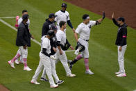 New York Yankees' Giancarlo Stanton, second from right, is greeted by manager Aaron Boone, right, after hitting a walkoff single during the ninth inning of a baseball game against the Washington Nationals at Yankee Stadium, Sunday, May 9, 2021, in New York. (AP Photo/Seth Wenig)