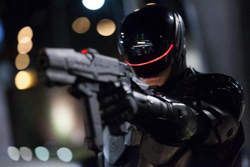 "This image released by Columbia Pictures shows Joel Kinnaman in a scene from ""RoboCop."" (AP Photo/Columbia Pictures - Sony, Kerry Hayes)"