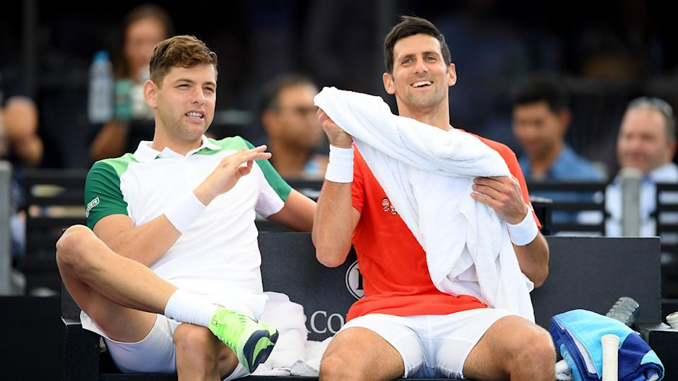 Seen here, Filip Krajinovic shares a laugh with Serbian compatriot Novak Djokovic.